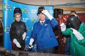 Advanced Education Minister John Yap tries his hand at welding earlier this month at Capilano University