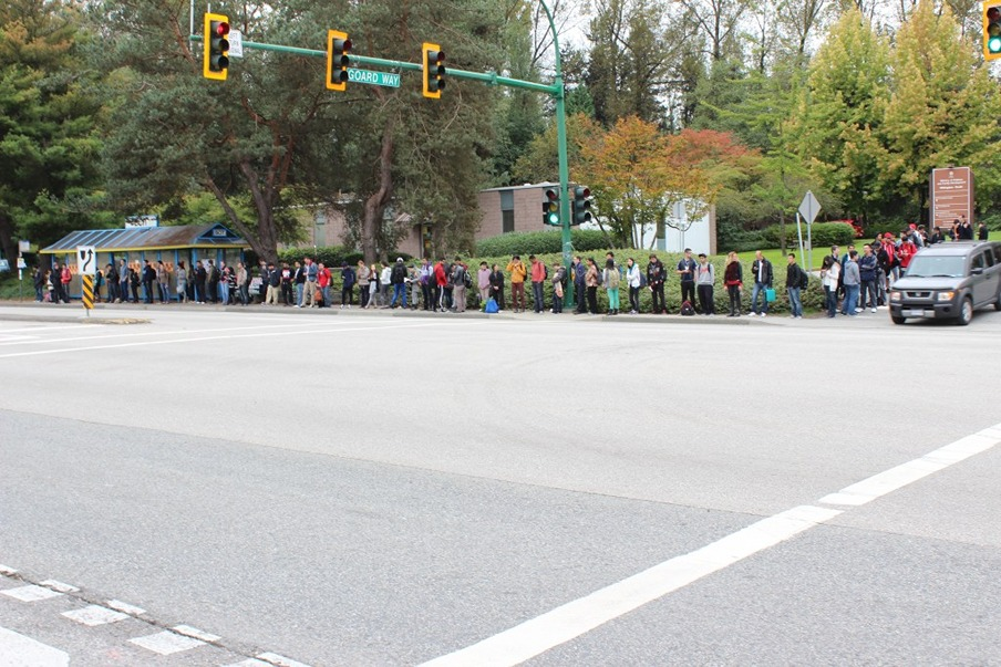 The wait to get on a bus can be very, very long. Photo by Laura Shortt.