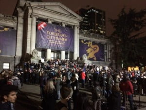 A crowd gathers in downtown Vancouver to hold a vigil for Paris' murdered.