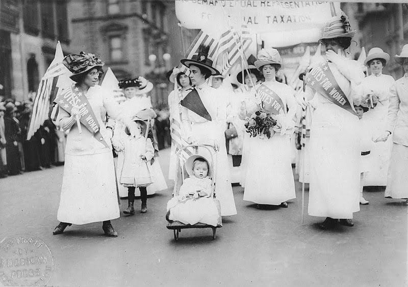 We've come a long way since this 1912 suffrage rally. But there's a long way to go.