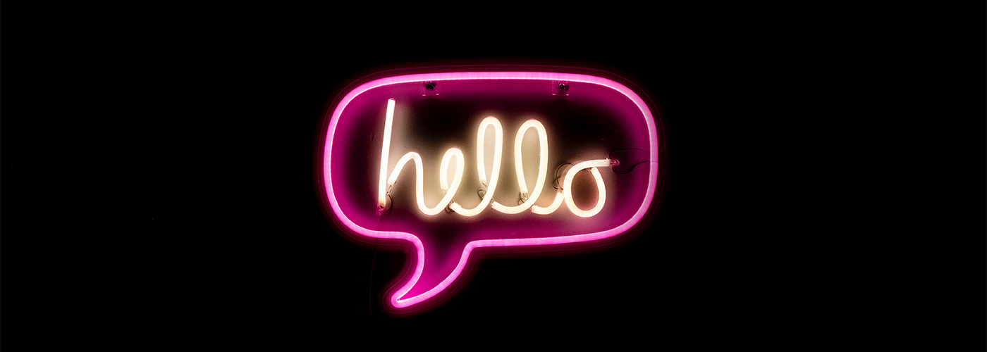contact us page feature image of neon light saying hello