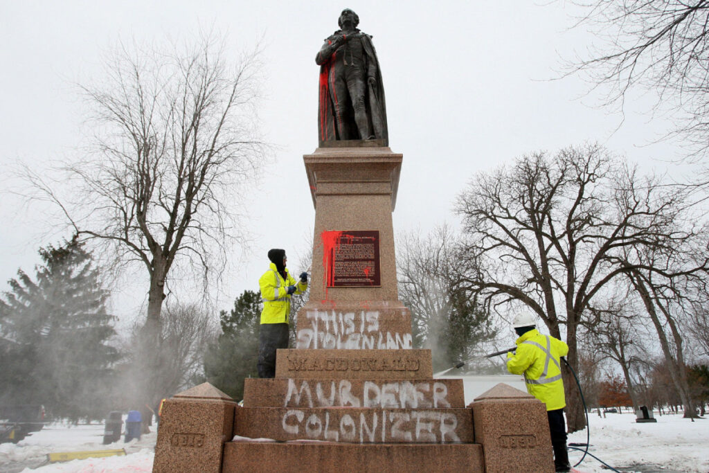 The John A Macdonald Statue in Montreal, covered with the message of those hurt by his legacy
